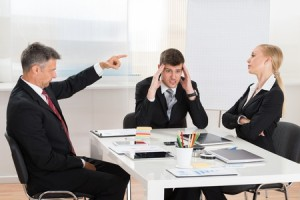 46636958 - mature businessman arguing with his two co-workers in office